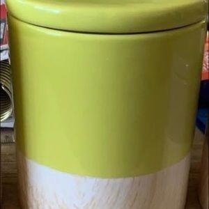 Glass jar with a wood like pattern bottom